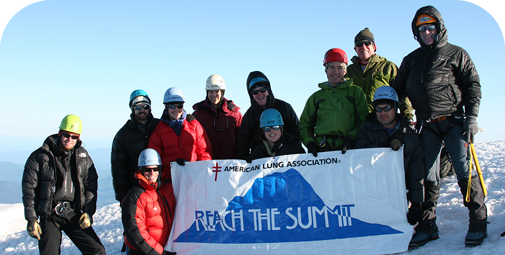 Reach The Summit Group with Banner
